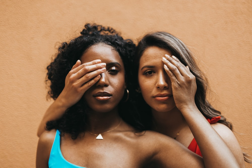 two women wearing bikini tops