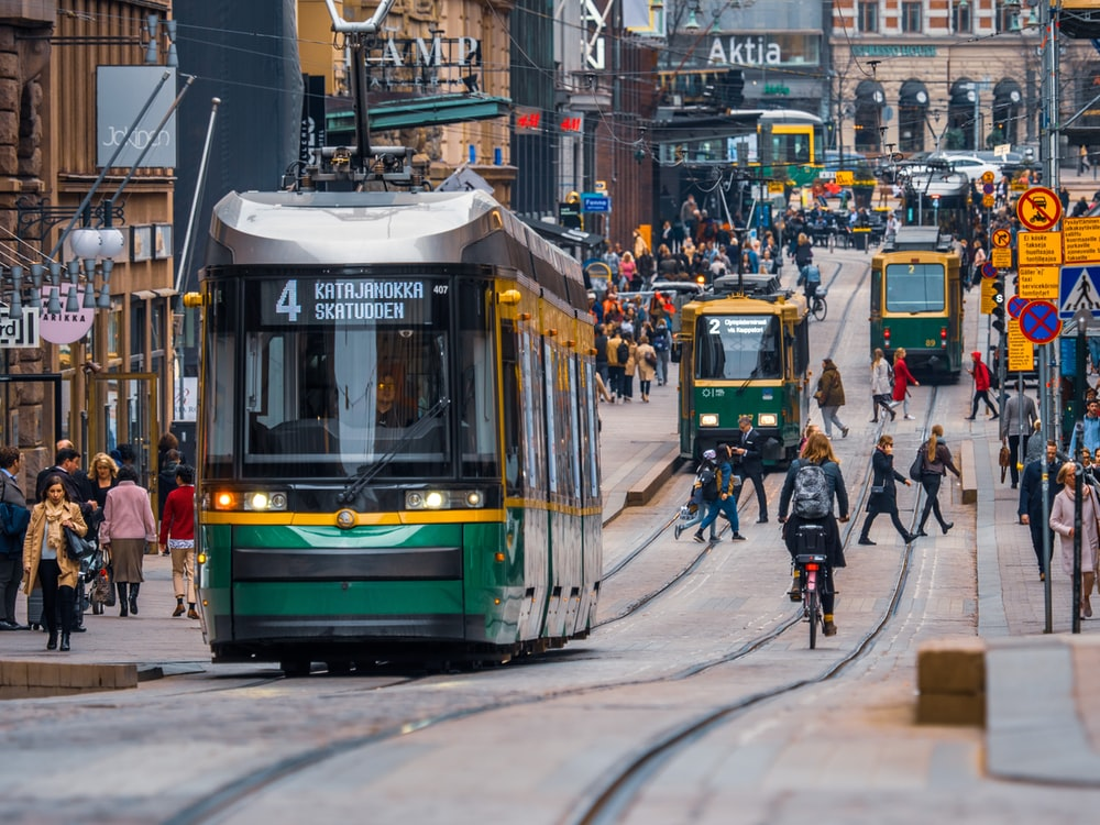 green and yellow city tram