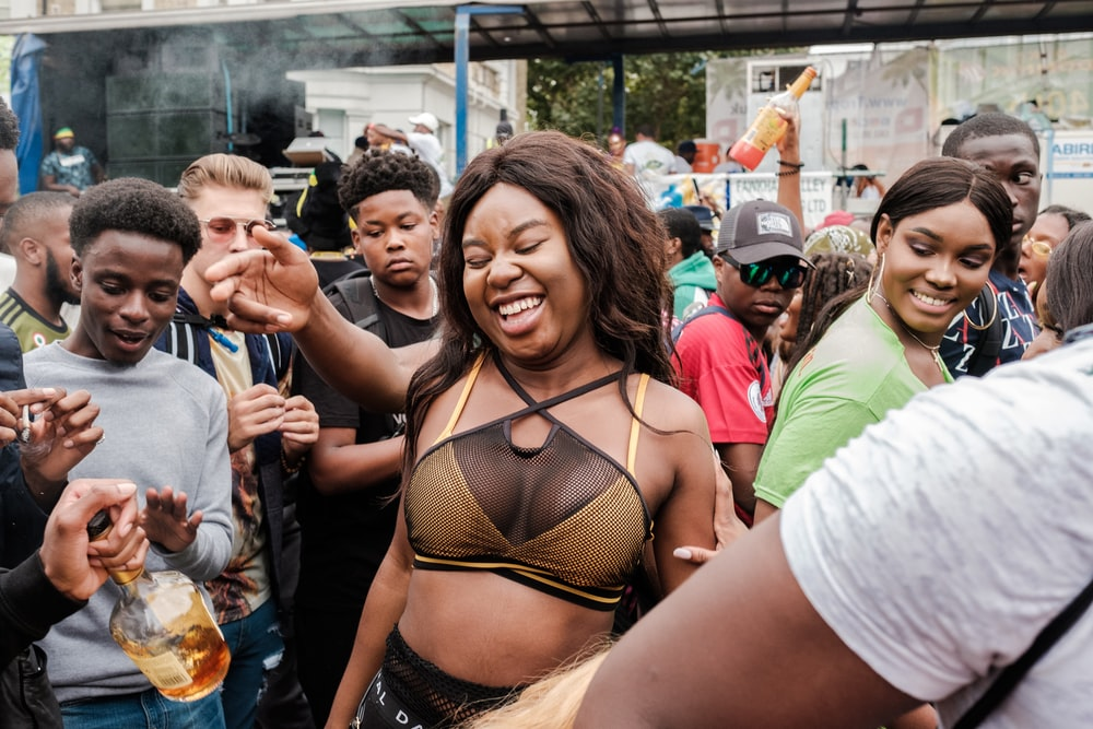 woman in brown bra near people