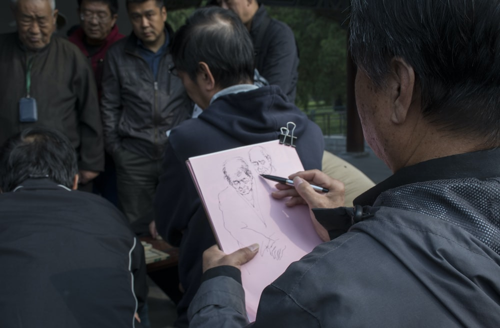 man sketching photography