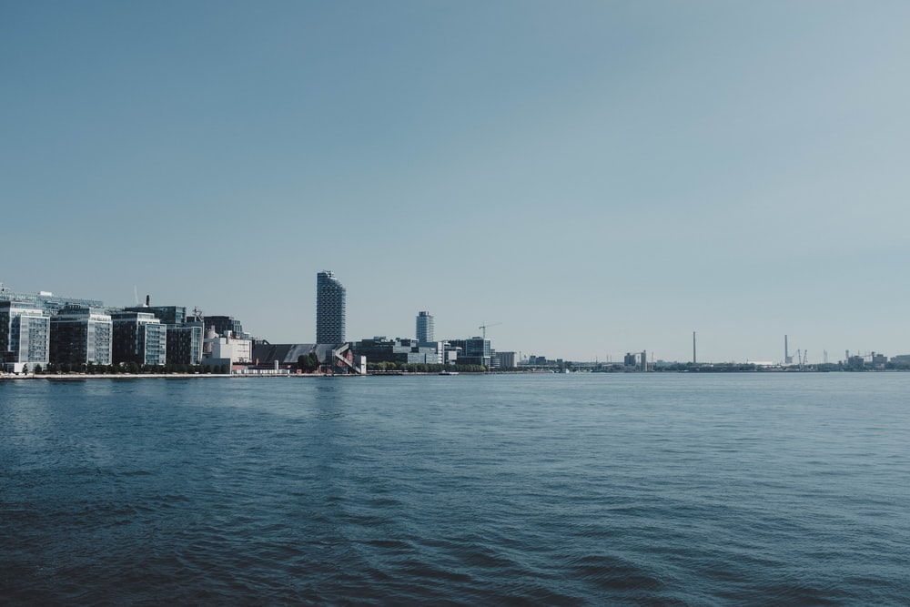 panoramic photography of city beside body of water