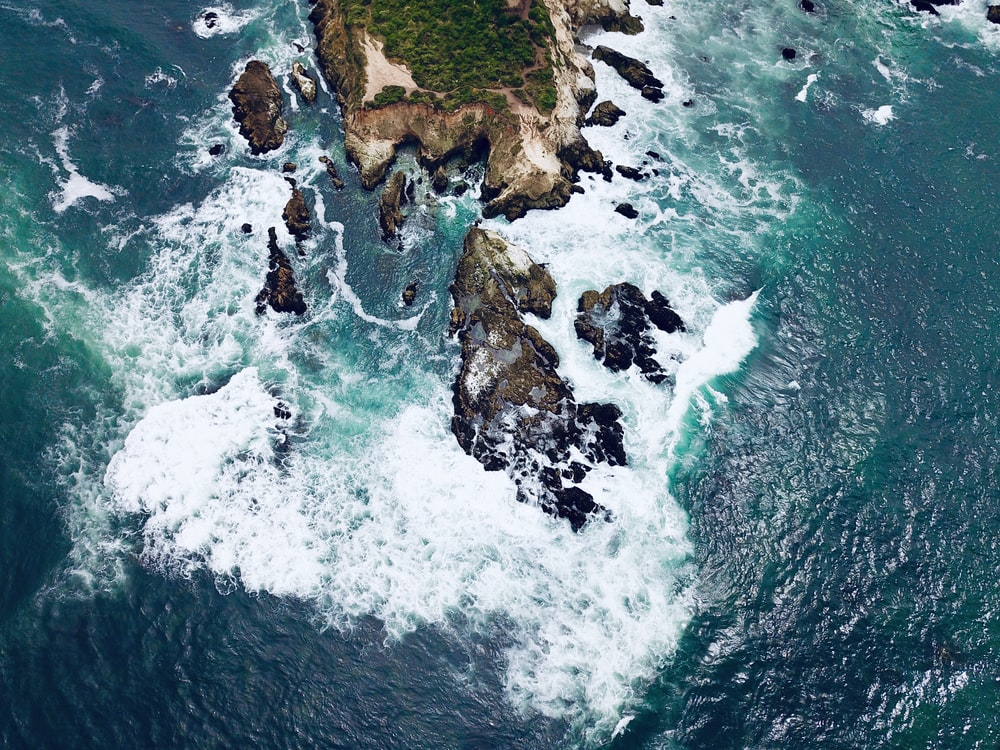 aerial photography of island surrounded with body of water