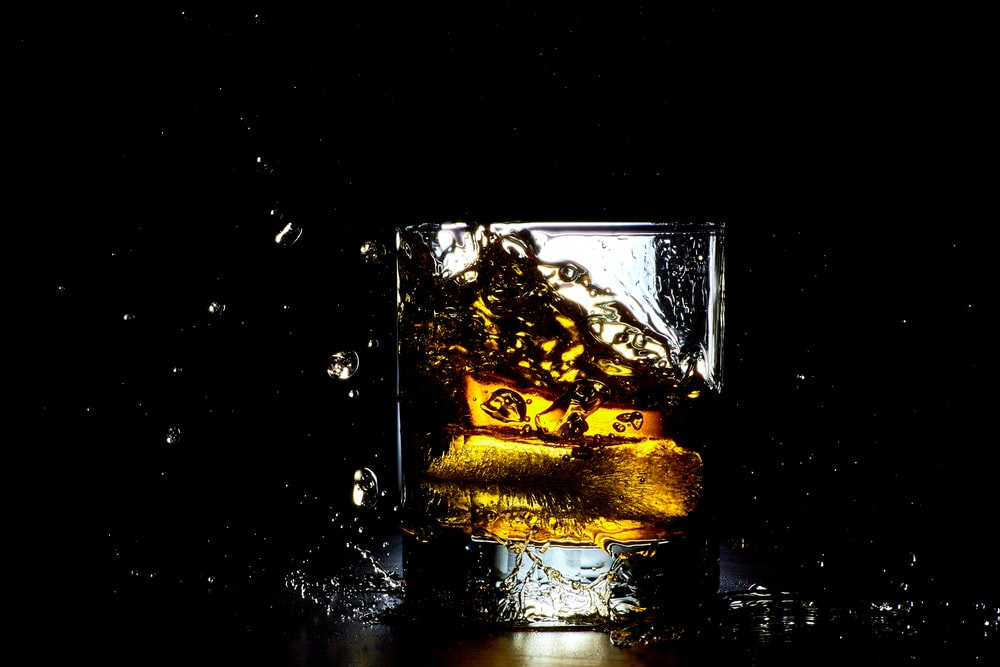 clear shot glass with ice and liquid