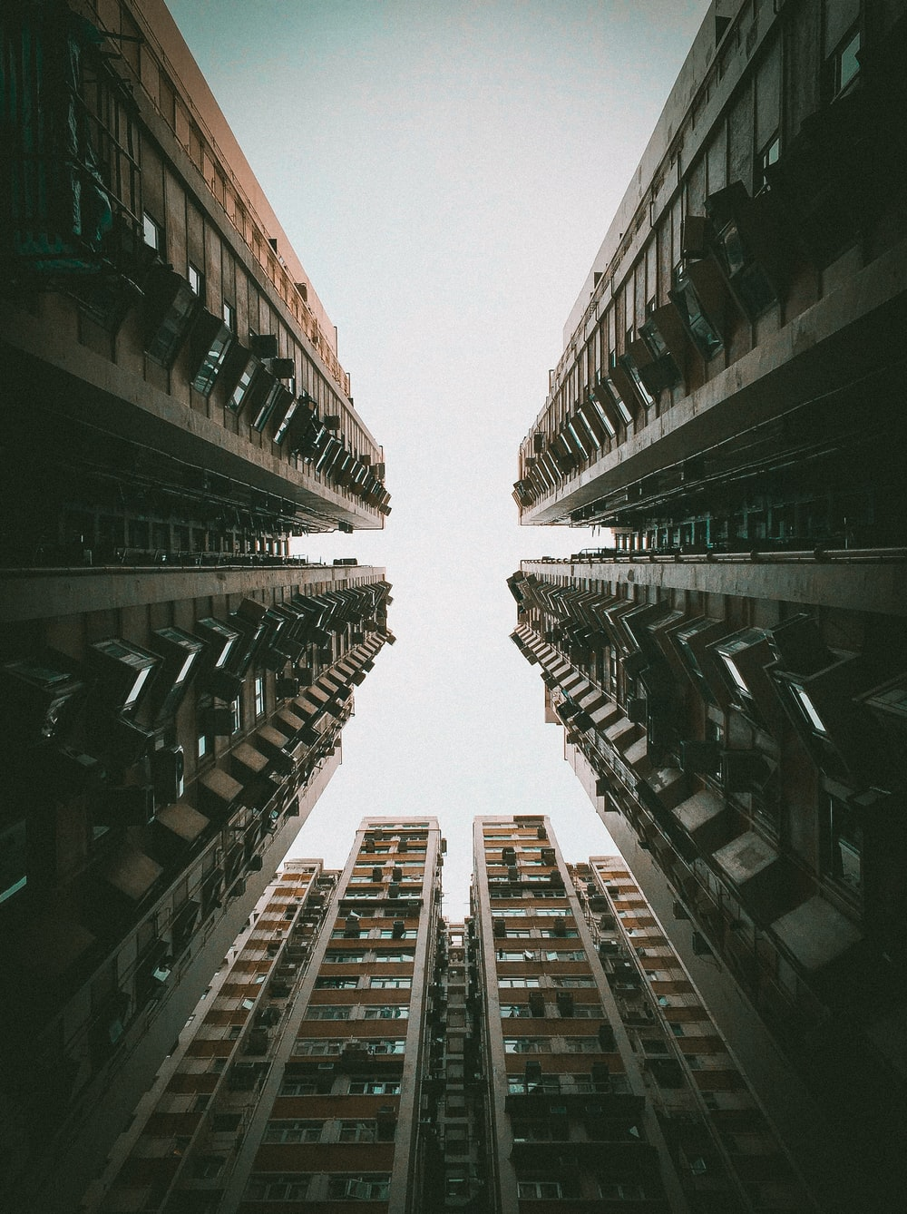 low-angle photo of high rise buildings