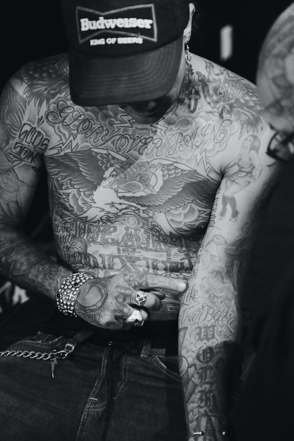 man with assorted body tattoo