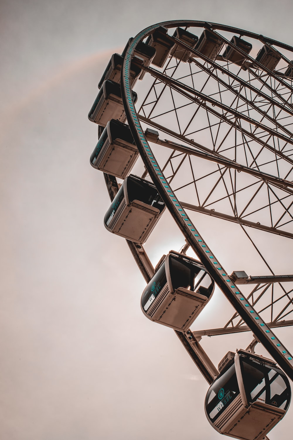 low-angle photography of brown ferris wheel