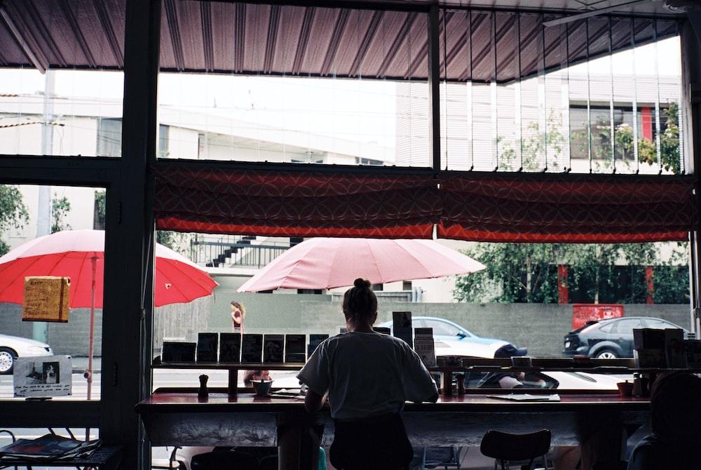 woman sitting inside cafe