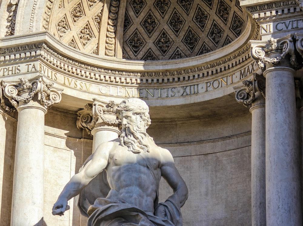 gray concrete Poseidon statue