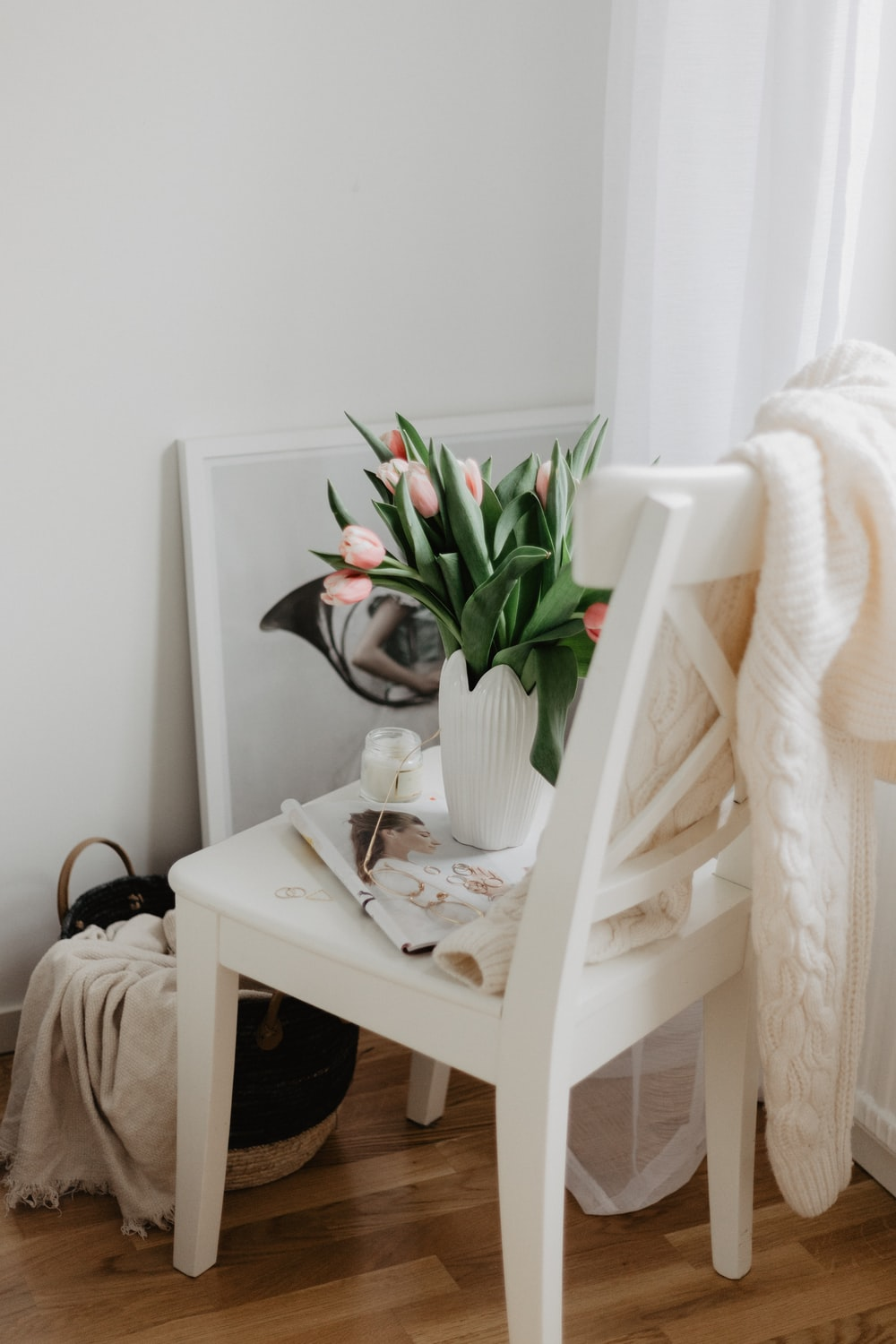 vase of tulips on chair