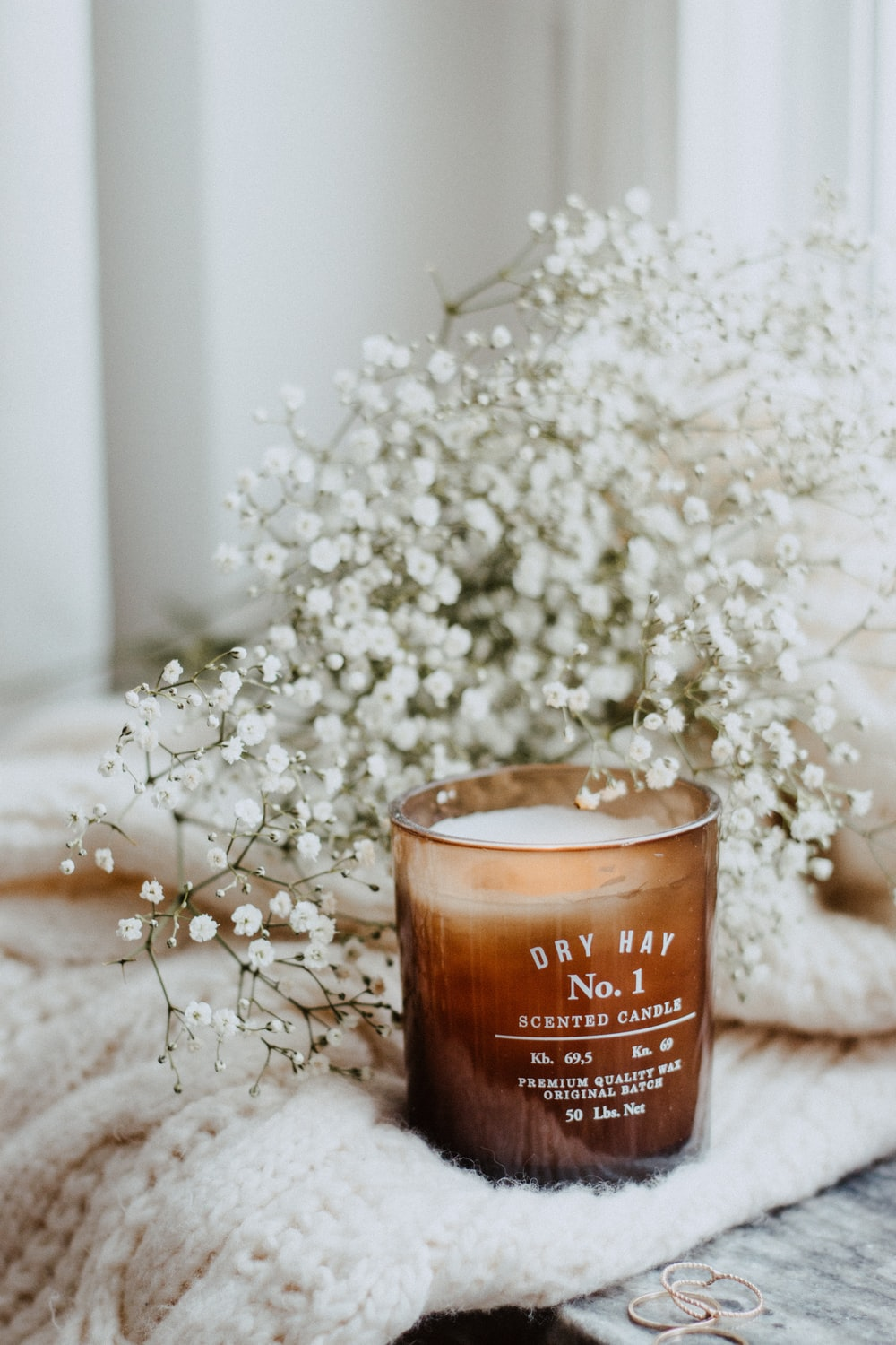 white petaled flower and pillar candle