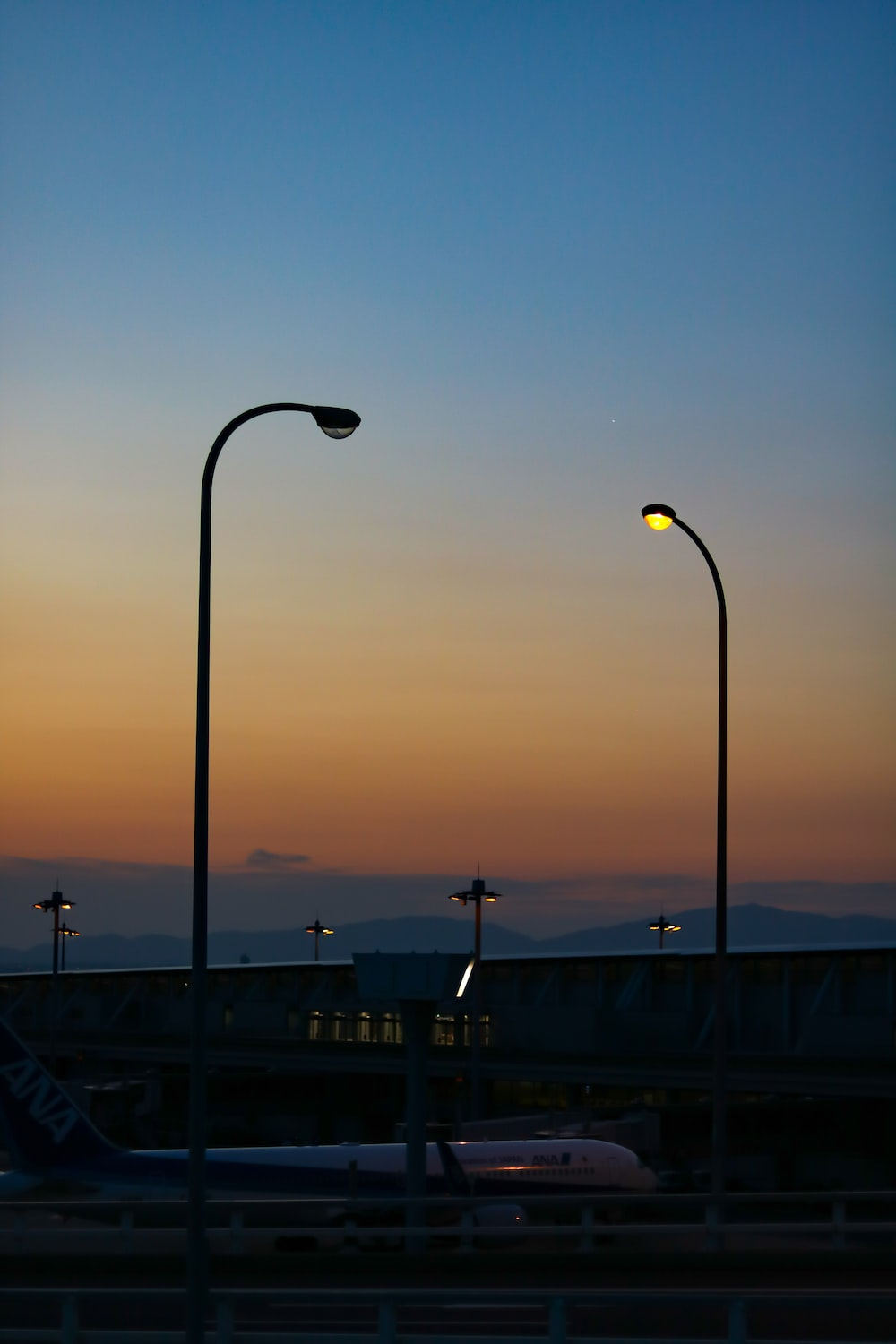lighted outdoor lamp post near buildings