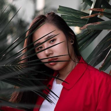 woman wearing red jacket