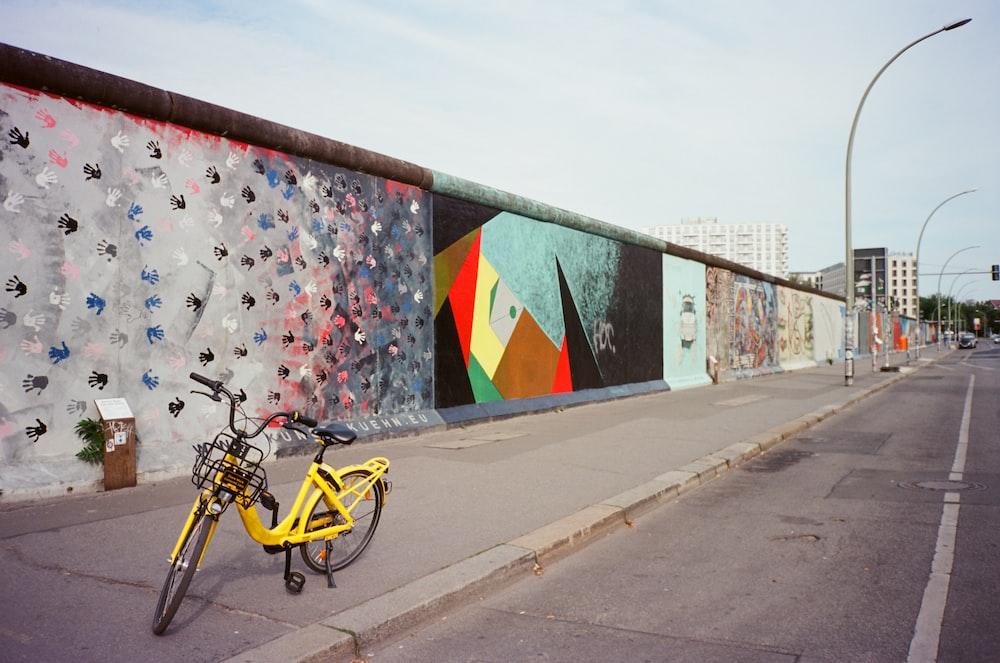 yellow bicycle near wall
