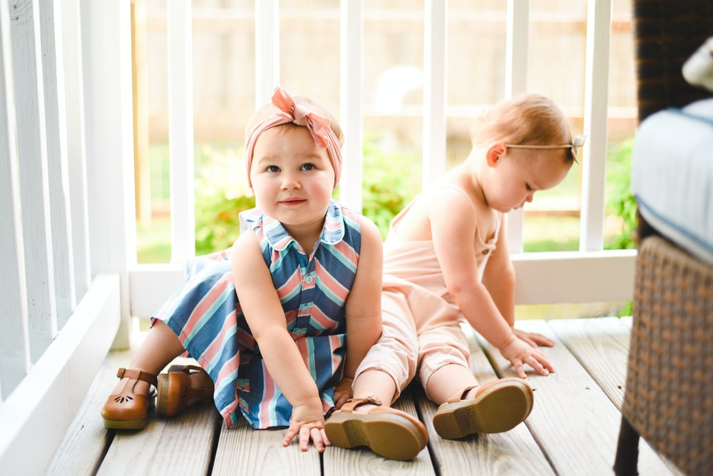 two babies on porch
