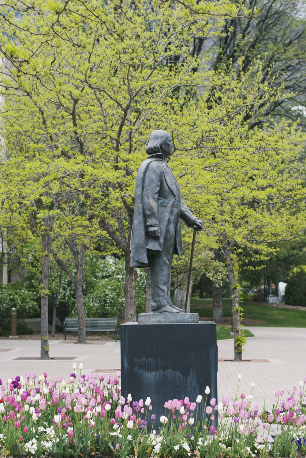 man statue surrounded by trees