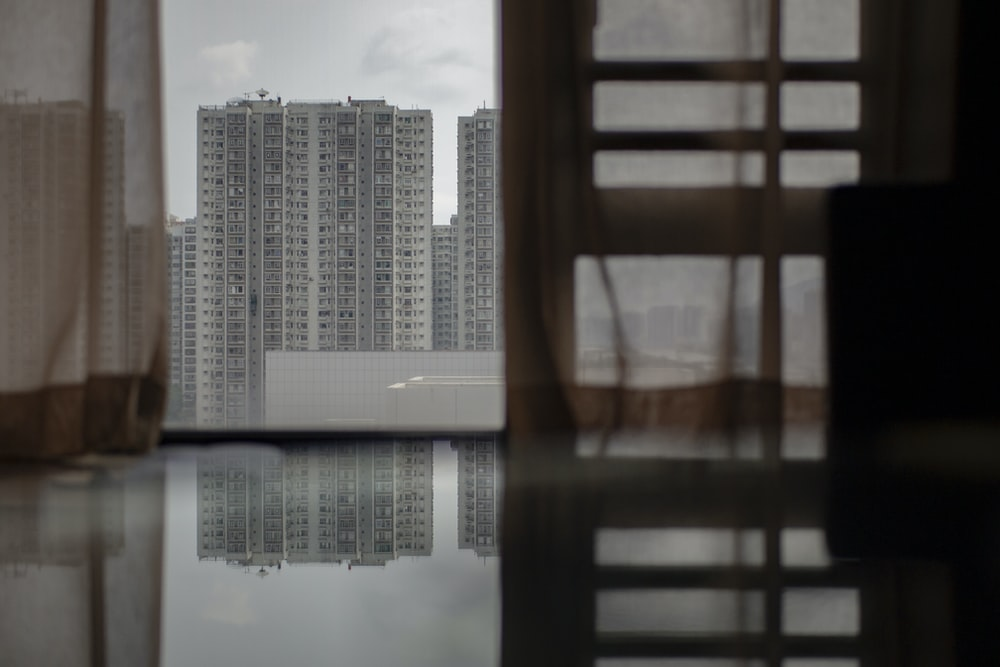 high rise buildings near body of water during daytime