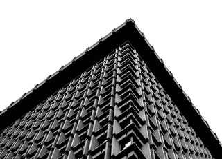low-angle photo of grey building