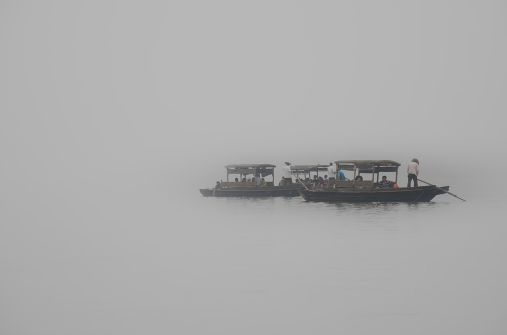 grayscale photography of passenger boat