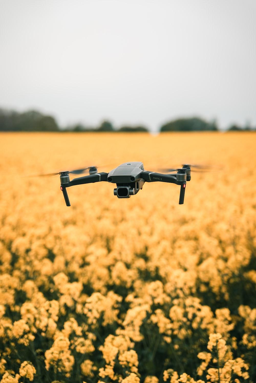 black drone during daytime