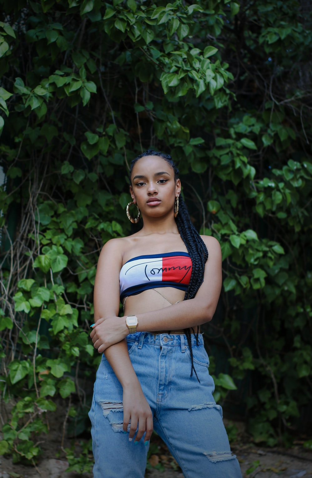woman wearing red and white crop top