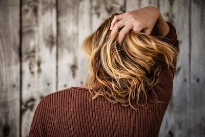 woman near wall hair zoom background