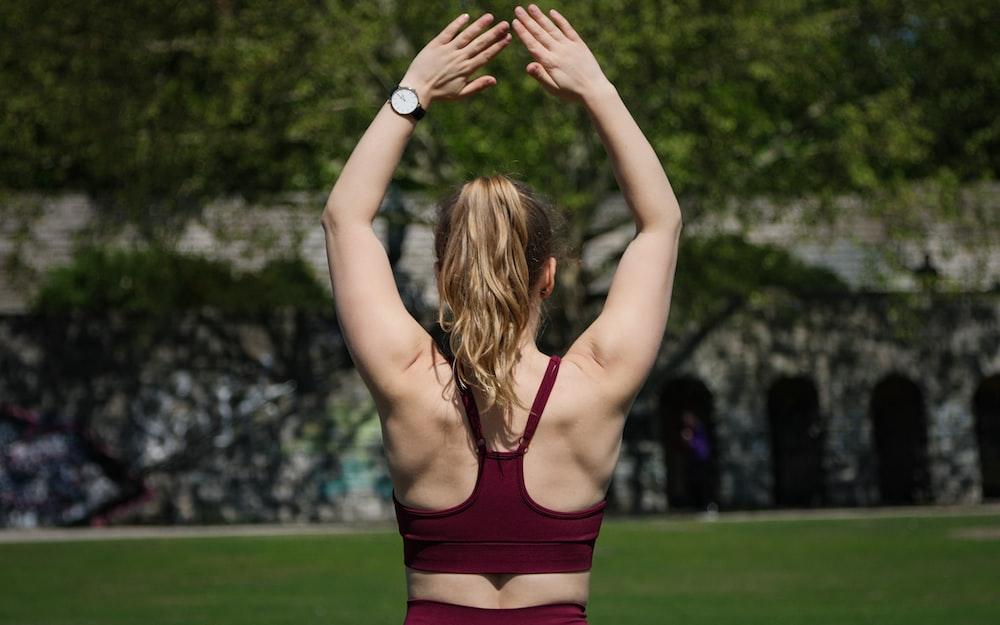 woman in maroon sports bra