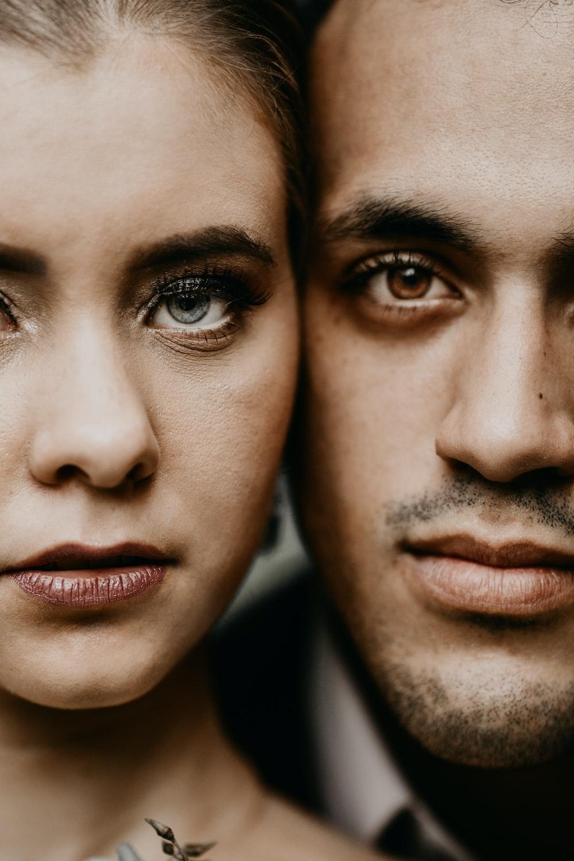 man and woman face close-up photography