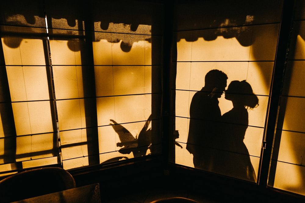 silhouette of hugging man and woman
