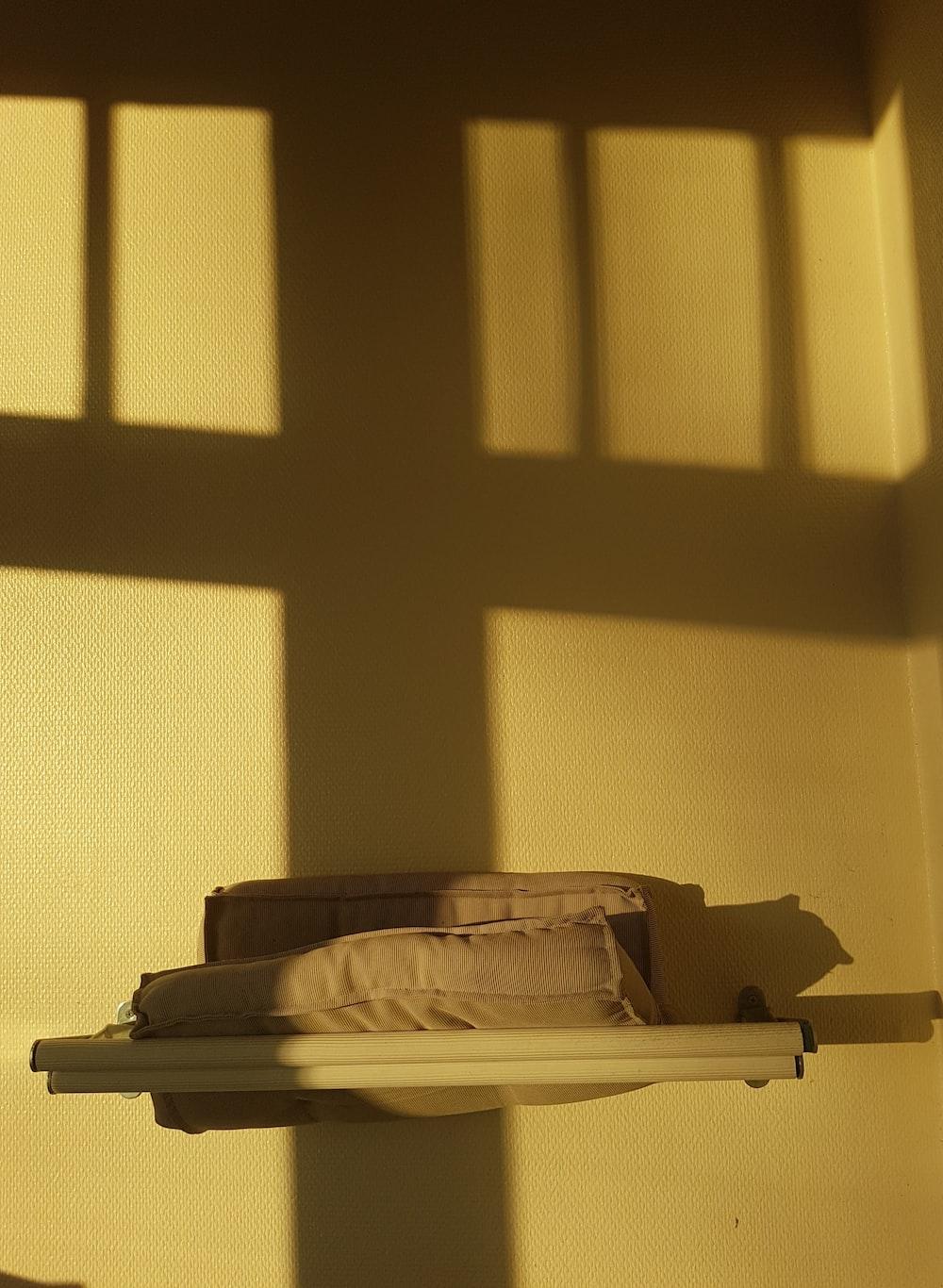 brown cushions on white wall shelf
