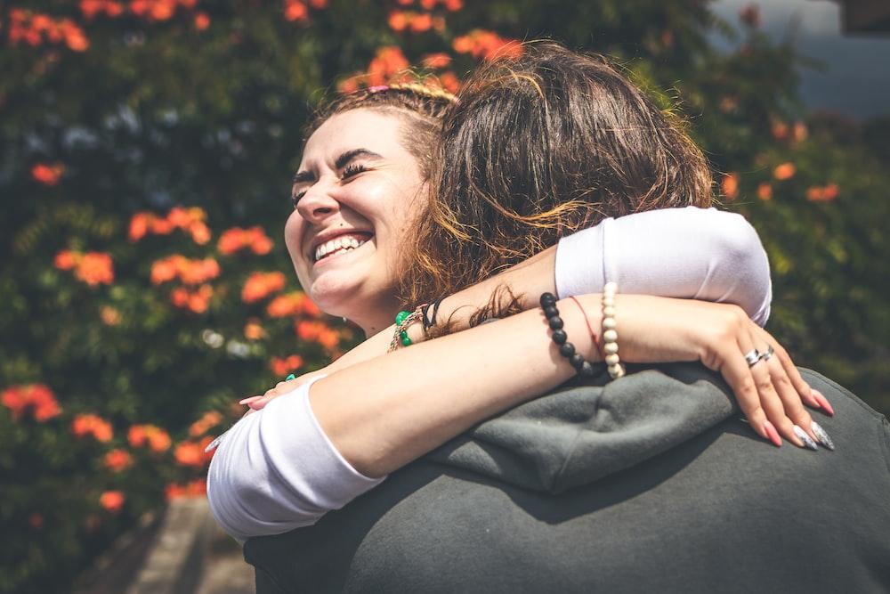 smiling woman hugging man