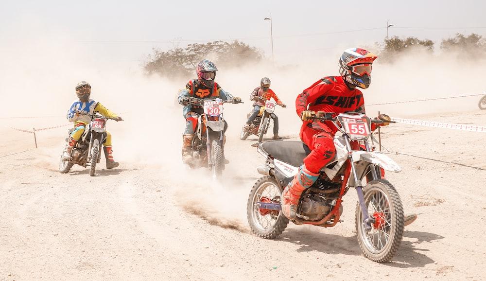 four men racing with motocross dirt bikes