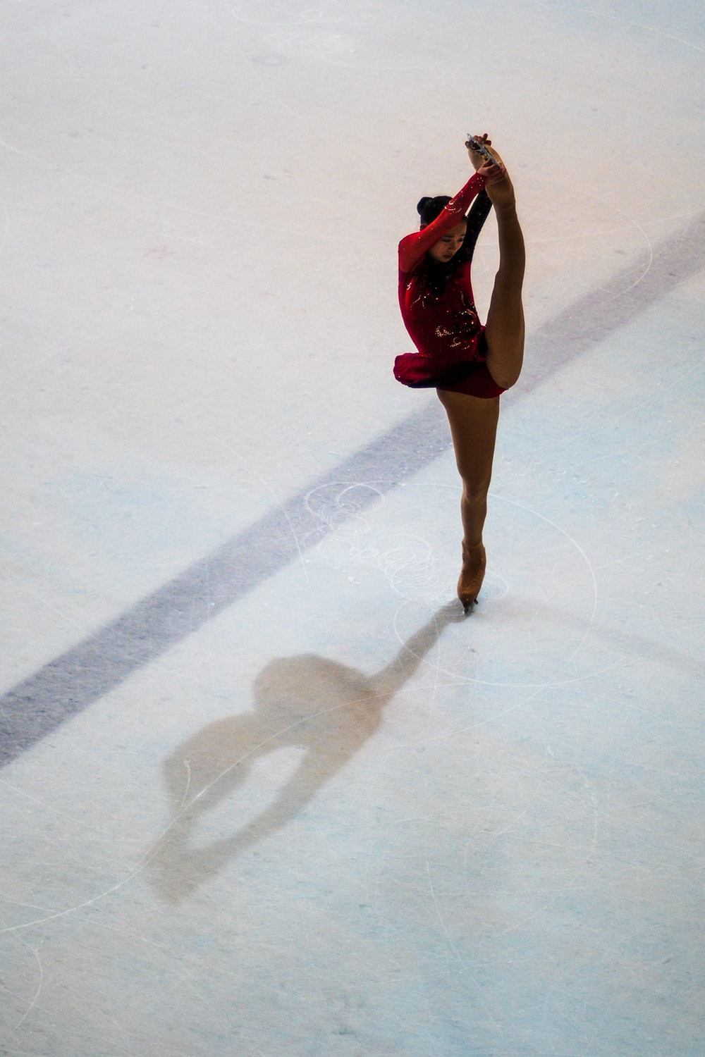 woman performing on ice skating rink