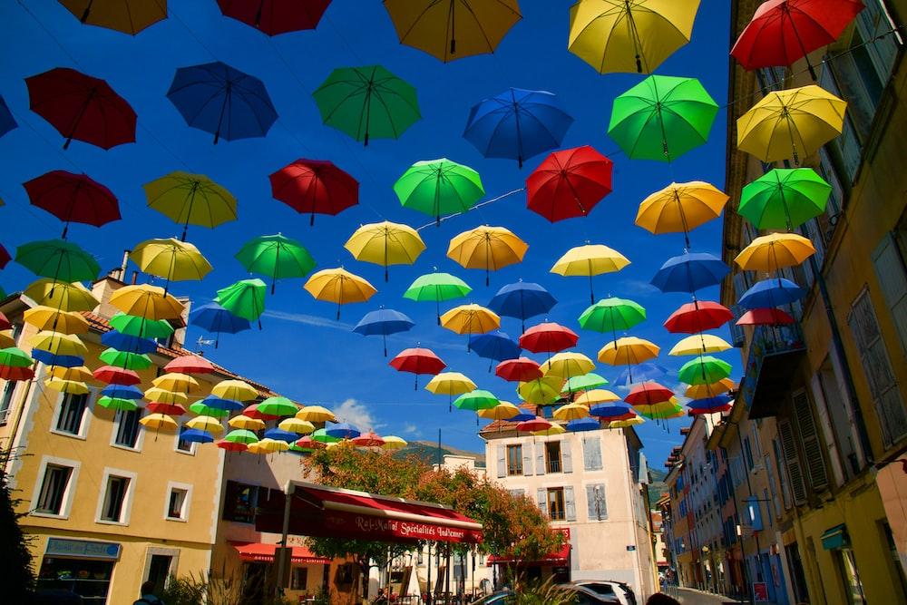 assorted umbrella above the street