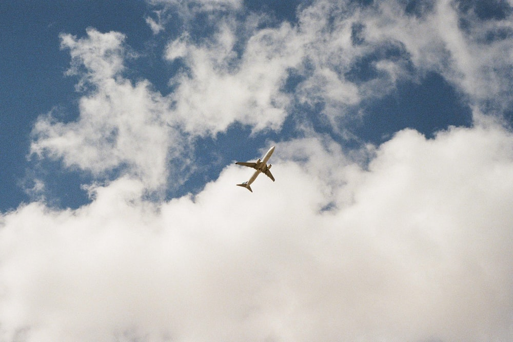 white airplane in air during daytime