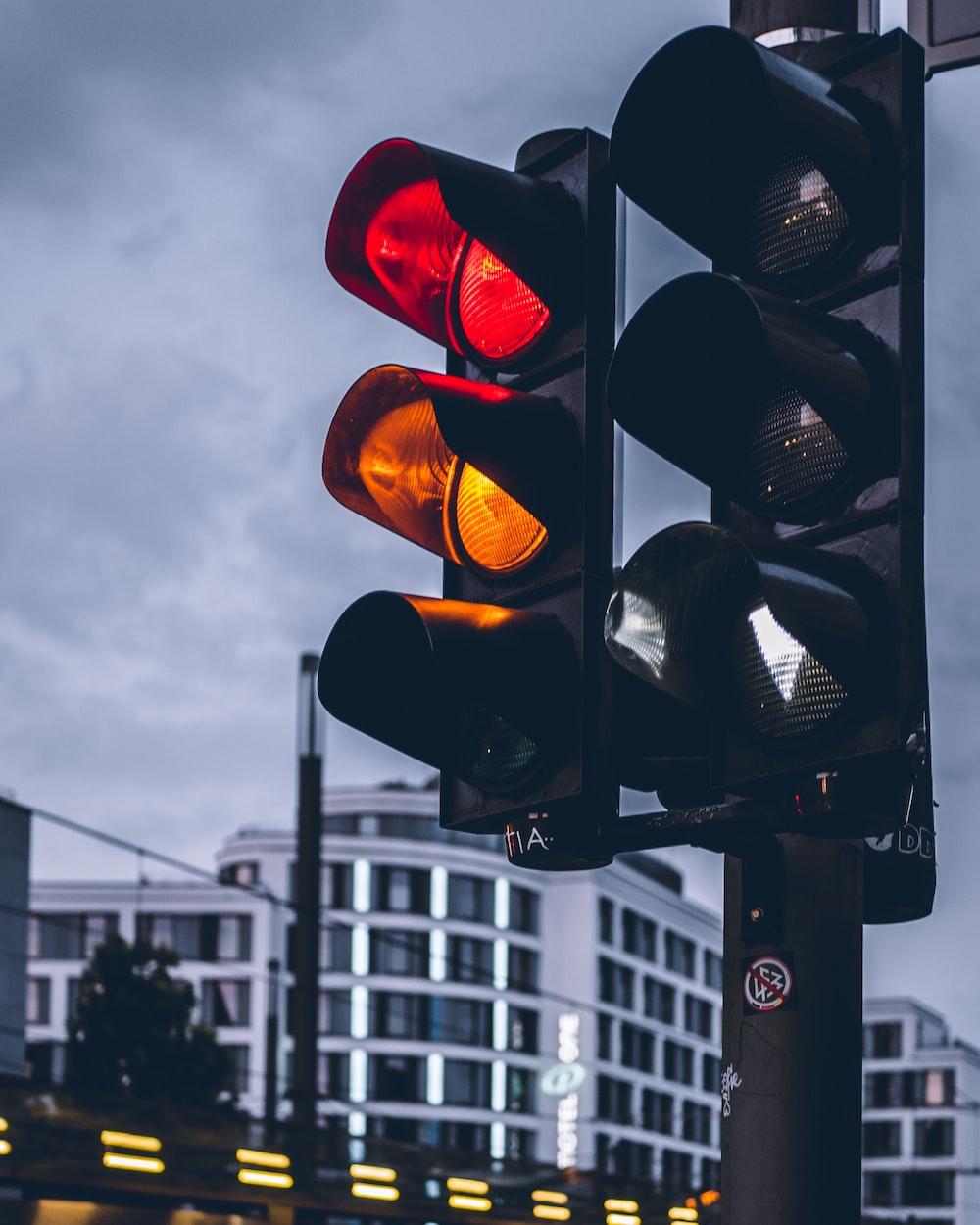 street traffic lights on red and orange