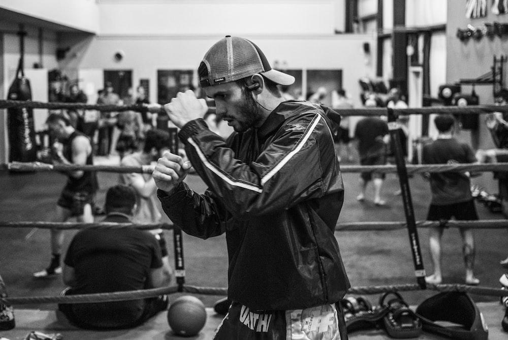 man wearing jacket in ring