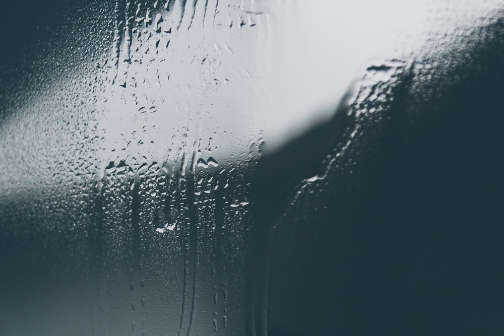 clear glass surface with moist