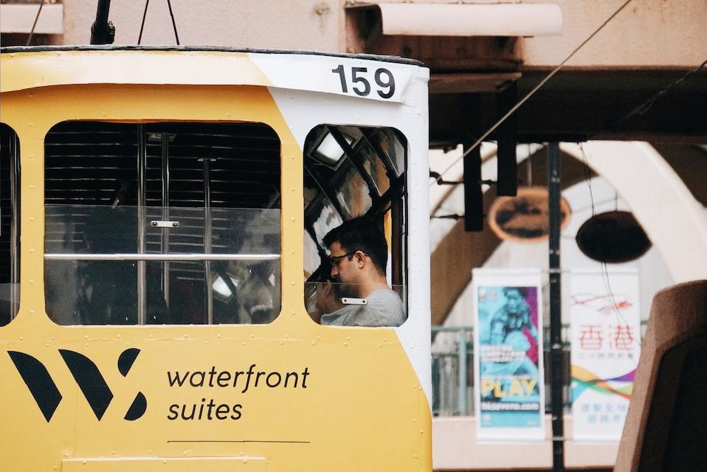 man riding in vehicle during daytime