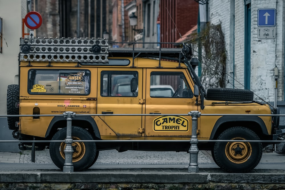 yellow vehicle parked near building