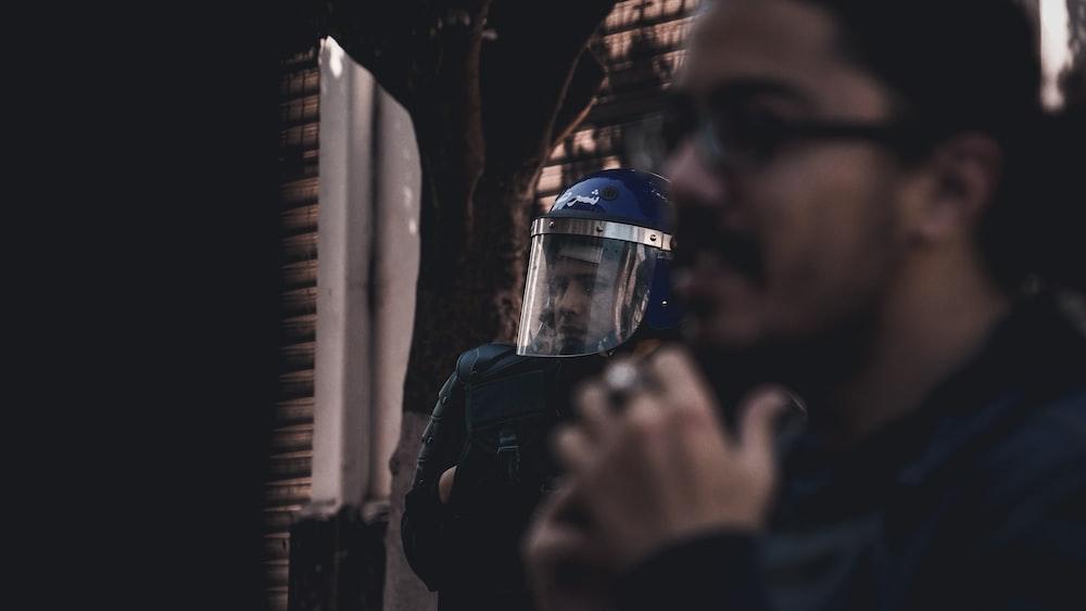 man wearing black protection helmet