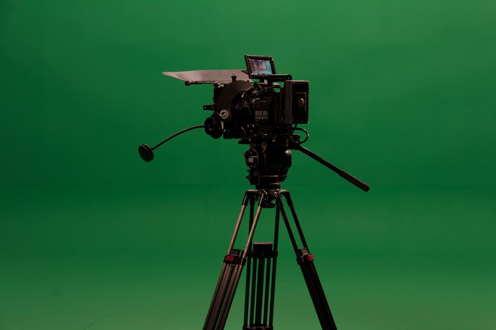 black camera on tripod