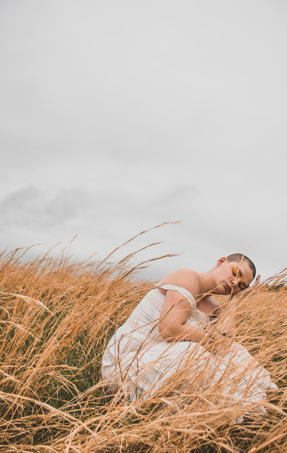 woman sitting on wheat grass