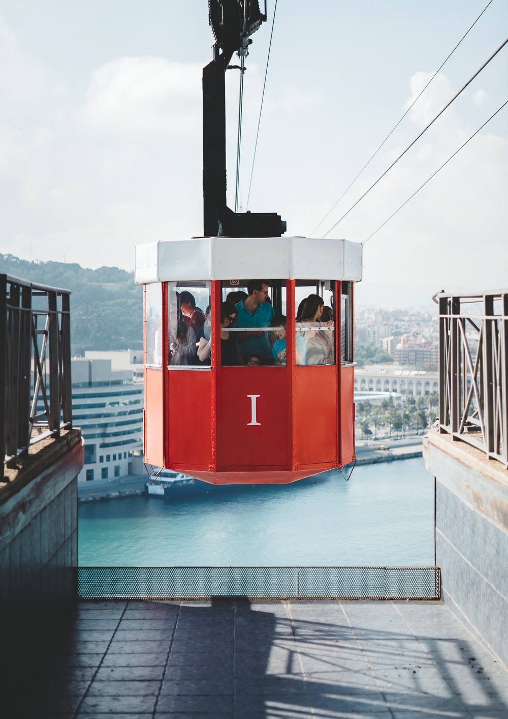 people riding on cable cart