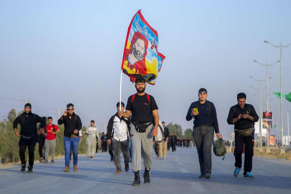 man in black T-shirt holding banner