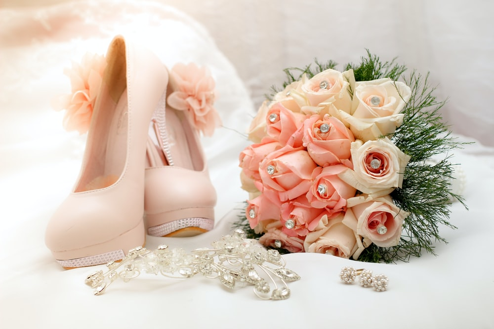 bouquet of flower beside sandals