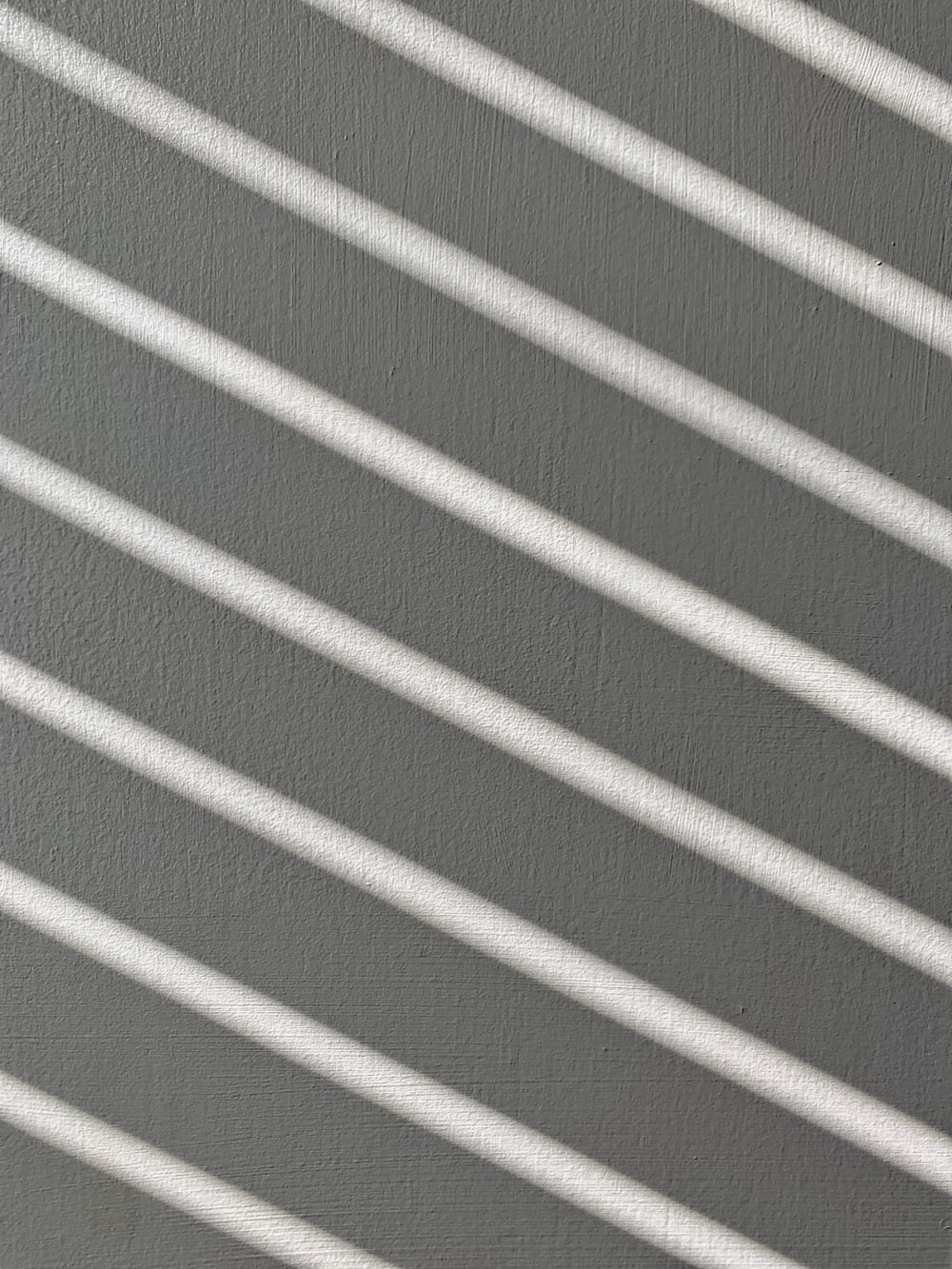 white and grey striped textile