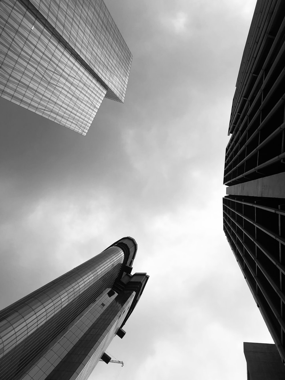 low-angle photography of three high-rise buildings