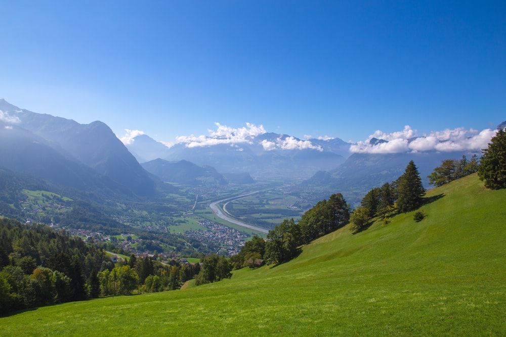 mountain near road at daytime ]