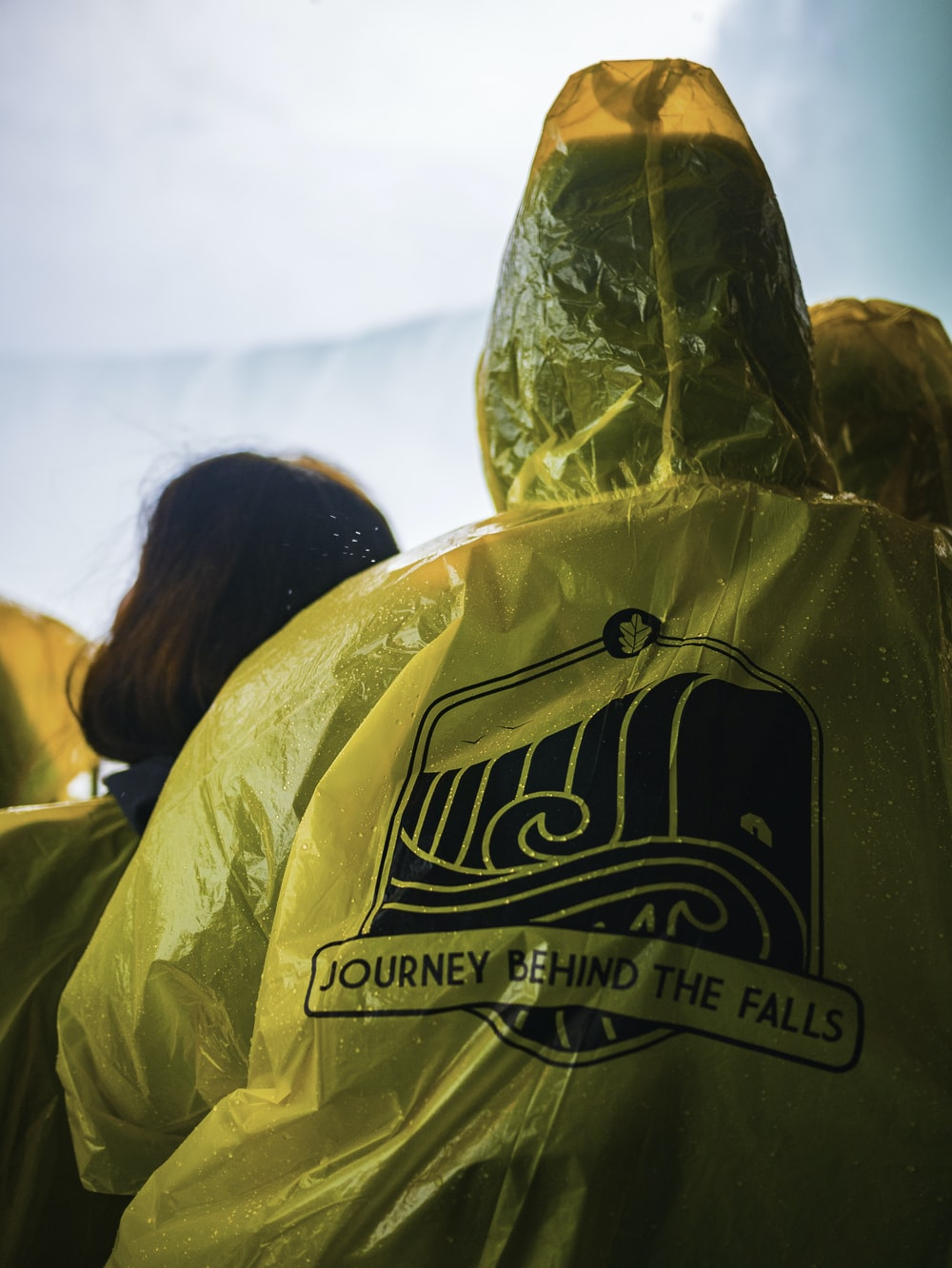 yellow Journey Behind the Falls raincoat