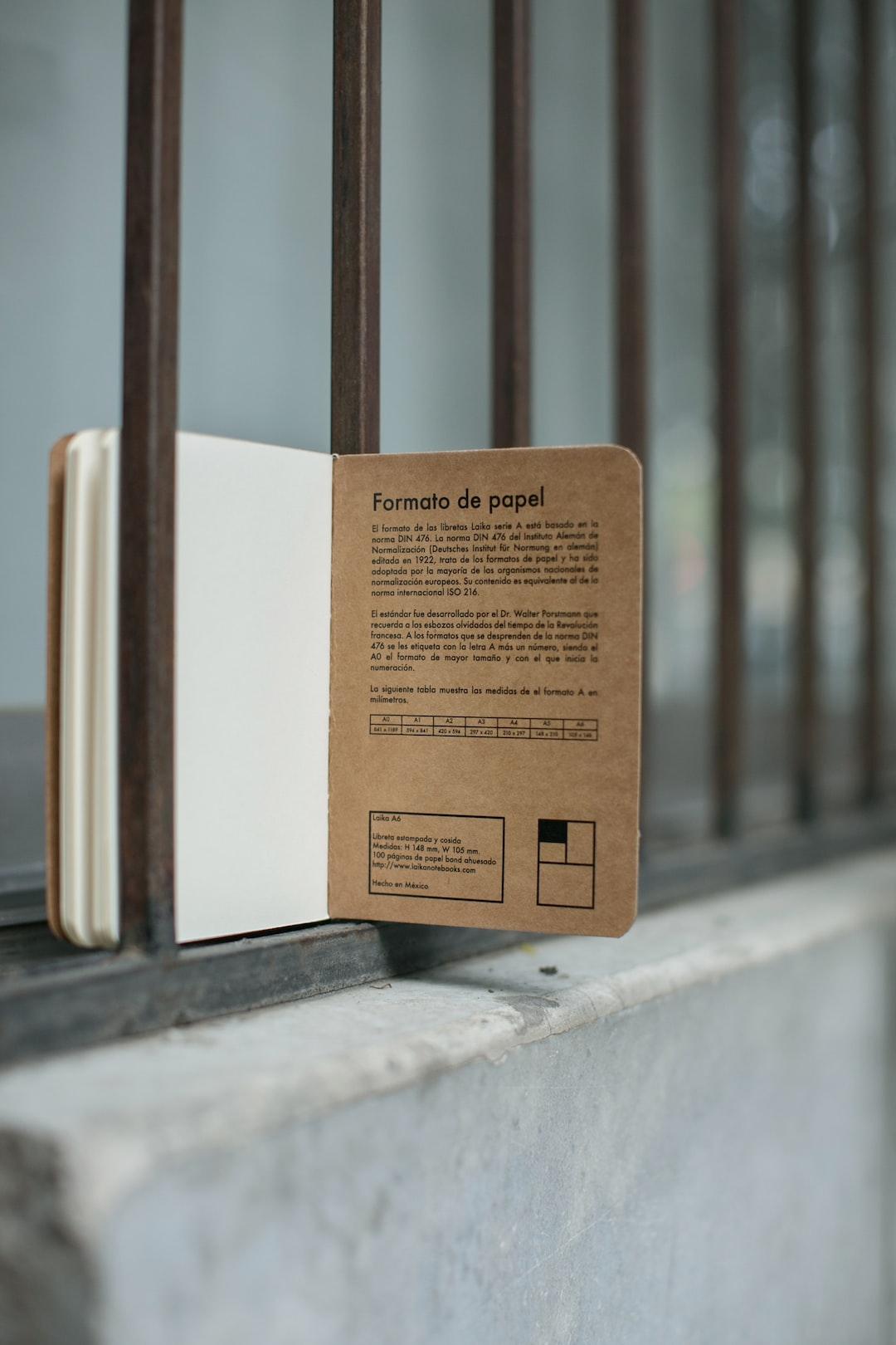 opened brown book on metal window grill photo free image on unsplash
